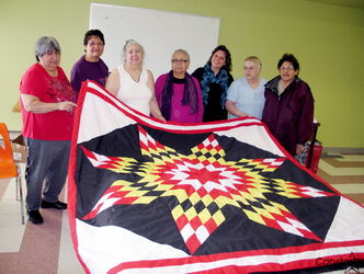 A group at Kekinan Centre show off one of many star blankets they've handmade. From left: Exilda Thompson, Sharron Hotomani, (free style sewing instructor), Darlene Clarke, Mary Hayes-Star Blanket, beading and leather moccasin instructor, Theresa La Jambe (Point Douglas Senior Resource Council), Jackie Spence (knitting and crocheting instructor) and Jesse Howell, Chair of Keteyasak Elders and Seniors Inc.