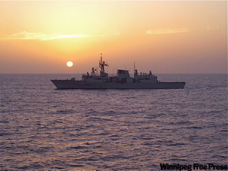 HMCS Winnipeg at sunset in the Gulf of Aden.
