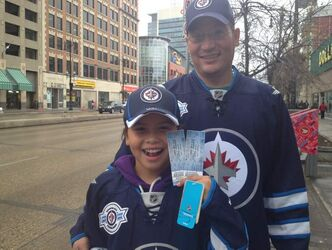 Jasmine Nepinak with her father and the tickets.