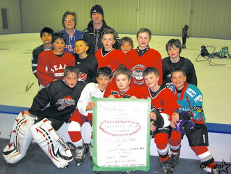 Southdale Seals 9A1 Red hockey team pictured at Southdale Community Centre. Back row, from left: Gayle Farkas, director of fundraising and communications, and Todd Thornton, president.