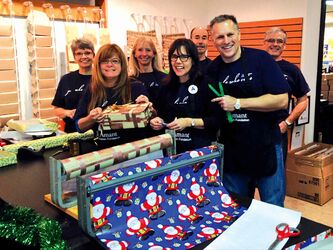 Volunteers from Investors Group Winnipeg South Regional Office, one of the sponsors of St.Amant Foundation's gift wrap and coat check station, are pictured hard at work.