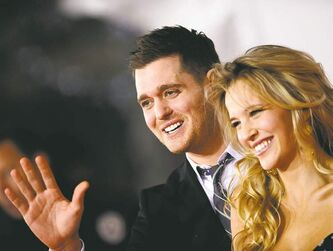 Luisana Loreley Lopilato, right, and Michael Buble attend the 2010 American Music Awards at the Nokia Theatre in Los Angeles, November 21, 2010. (Lionel Hahn/Abaca Press/MCT)