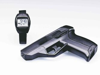 The watch makes the gun think. Electronic chips inside the Armatix iP1 and watch communicate with each other. If the watch is within close reach of the gun, a light on the grip turns green. Fire away.