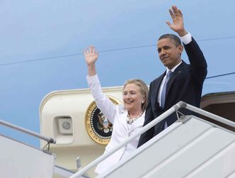 U.S. President Barack Obama and Secretary of State Hillary Rodham Clinton wave as they arrive at Yangon International Airport in Yangon, Myanmar,on Nov. 19, 2012.