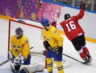 Jonathan Toews waking up a nation with a golden game-winning goal. Winnipeg's Toews was the most dominant player in the biggest game of the tournament. He checked, he scored and he lifted Canadians out of their church pews, bar stools and easy chairs. The image of him picking up a Canadian flag and skating around the Bolshoy IceDome with a gold medal around his neck will stick in the minds of Canadians and Manitobans forever.