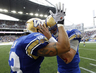 James Green (left) celebrates with quarterback Justin Goltz after Goltz scored his first touchdown of the Banjo Bowl Sunday.