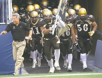 during Manitoba Bisons home against the University of Alberta Golden Bears Friday night  -See story- August 30, 2013   (JOE BRYKSA / WINNIPEG FREE PRESS)