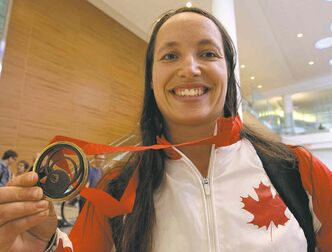 Marie-Josée Arès-Pilon arrived at Winnipeg's airport without an entourage but with her Commonwealth Games bronze medal in tow.