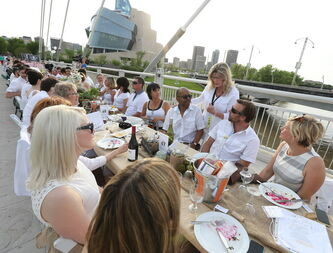 Saint Boniface MP Shelly Glover (standing) chats with diners at the Table for 1200 event on the Esplanade Riel Bridge Saturday evening.