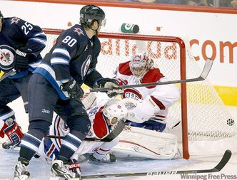Nik Antropov scores the first goal for the Winnipeg Jets 2.0, putting the puck past Carey Price in the third period.