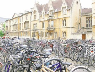 Bicycles crowd a quadrangle at Oxford. Cycling remains a popular mode of transportation for gown-wearing students at the university.