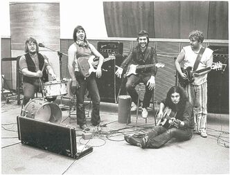 The Guess Who (with Winter, in his striped pants) in a Chicago studio recording Hand Me Down World in 1970.