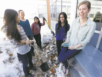 Sisler High School teacher Lauren Sawchuk with students Roveen Cheema, Charmaine Agsalud, Lisa Huang and Keisha Mendoza.