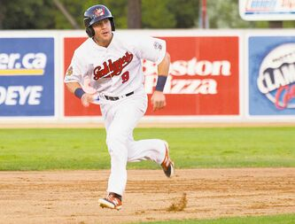 Goldeyes second baseman Brock Bond tears to third base Friday in the fifth inning against the Gary Southshore Railcats.