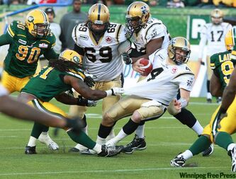 Winnipeg Blue Bombers quarterback Buck Pierce is hauled down by an Edmonton Eskimos defender Saturday at Commonwealth Stadium in Edmonton Saturday. The Eskimos won 24-10.