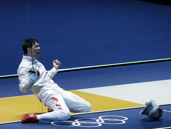China's Man Zhong reacts after defeating South Korea's Junghwan Kim during the men's individual sabre round of 32 fencing at the 2012 Summer Olympics, Sunday, July 29, 2012, in London. (AP Photo/Andrew Medichini)