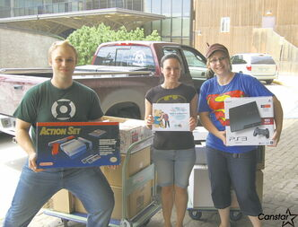 (From left) Steve Noel, Kate-Lyn West, and Jessica Stehr deliver donations to the Children's Hospital earlier this year.