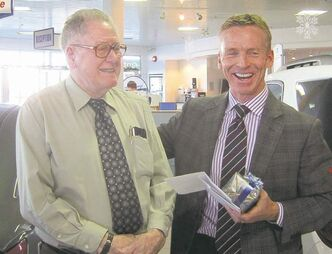 Bob McKee with Murray Chev president Dan Murray at McKee's retirement  reception.