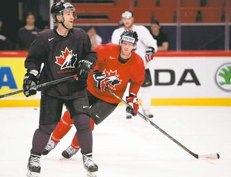 Canada's Stephane Robidas (left) and team captain Eric Staal skate during practice Thursday in Stockholm. The Canadians will open the tournament against Denmark on Saturday.