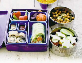 A Japanese bento box and Indian Tiffin shown here offer a multinational version of the traditional brown bag lunch.