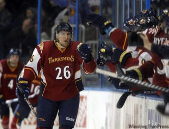 In this file photo, Atlanta Thrashers right-wing Blake Wheeler (26) celebrates after scoring in the second period of an NHL hockey game against the Florida Panthers in Atlanta, Feb. 25, 2011 in Atlanta. On Monday, The Jets announced they reached a contract deal with Wheeler.