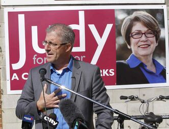 Mayoral candidate Gord Steeves speaks near rival candidate and front-runner Judy Wasylycia-Leis' campaign office on Portage Avenue Tuesday.