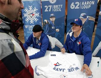 Fans in line to get autographs from Toronto Blue Jays Brett Cecil and Aaron Loup who are in town while on a cross-country fan appreciation tour. Organizers of the event are unofficially saying around 2500 fans showed up to get a chance to meet Jays' Brett Cecil (left), Aaron Loup (right) and Jose Bautista at Polo Park mall Sunday.