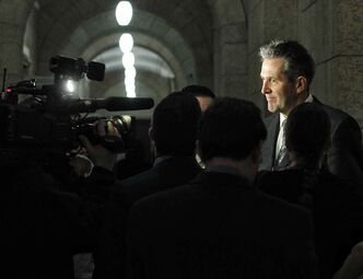 Opposition leader Brian Pallister talks to reporters during a scrum at the Manitoba Legislative Building Thursday afternoon.
