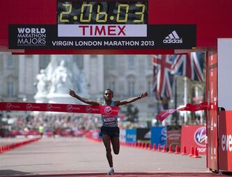 Tsegaye Kebede of Ethiopia crosses the line to win the men's London Marathon in the Mall, Sunday, April 21, 2013. A defiant, festive mood prevailed Sunday as the London Marathon began on a glorious spring day despite concerns raised by the bomb attacks on the Boston Marathon six days ago, as thousands of runners offered tributes to those killed and injured in Boston, with a moment of silence before the race, and many wore black ribbons as a sign of solidarity.(AP Photo/Alastair Grant)