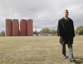 City of Winnipeg councilor John Orlikow walks away from giant metal silos being that were erected on the BNSF Railway line on Lindsay Street and Mathers Avenue last week. Local residents say they do not belong in a residential neighborhood.