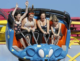 Ashton Wisener, Kyra DeLaRonde, Raeven O'Brien and Erica Reeves (from left) enjoy a ride on the Crazy Mouse at the Red River Ex.  John Woods / Winnipeg Free Press