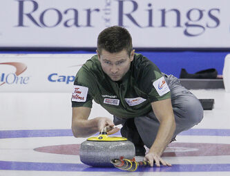 Skip Mike McEwen throws during draw 8 against John Epping at the Roar Of The Rings.