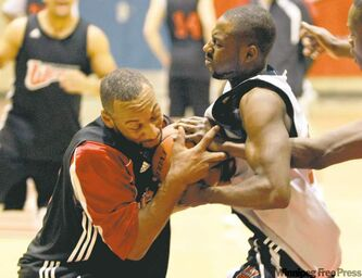 University of Winnipeg Wesmen teammates Nolan Gooding and Craig Sharpe battle for the ball during practice Wednesday while preparing to host the crosstown rival Bisons in the Duckworth Challenge.