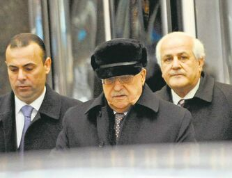 Palestinian President Mahmoud Abbas (centre) leaves the United Nations Plaza Hotel Friday in New York.