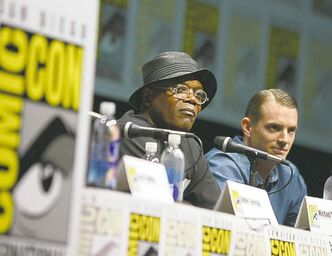 Samuel L. Jackson, left, and Joel Kinnaman at Comic-Con's RoboCop panel.