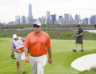 With Manhattan in the background, Kevin Stadler (Walrus Jr.) stalks the fairway at The Barclays in Jersey City, N.J., on Friday.
