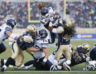 Winnipeg Blue Bombers defender Don Unamba (41) can't stop Toronto Argonauts running back Curtis Steele from flying in for a touchdown during the first half of a CFL pre-season game at Investors Group Field in Winnipeg Monday.