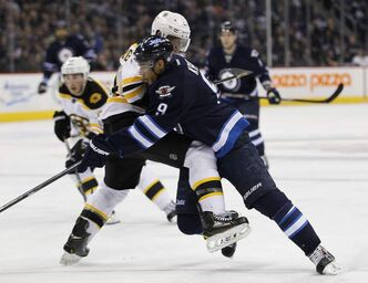 Winnipeg Jets forward Evander Kane attempts to get around Boston Bruins defenceman Dennis Seidenberg during second-period NHL action at the MTS Centre in Winnipeg on Tuesday night. The Jets scored three goals in the third period to defeat the Bruins 3-1.