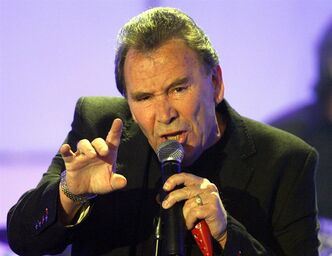 FILE - In this Tuesday, April 29, 2008 file photo Reg Presley, frontman of British rock group The Troggs, performs in a TV studio in Huerth,near Cologne, Germany during the recording of the 50th