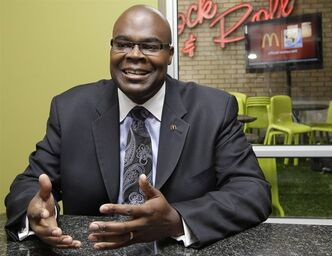 "FILE - In this Thursday June 10, 2010, file photo, McDonald's President Don Thompson,speaking during an interview with the Associated Press in Sandton, Johannesburg, South Africa. McDonald's CEO Don Thompson revealed at an analyst conference during the last week of May 2013 that he shed about 20 pounds in the past year by ""working out again,"" but still eats McDonald's every day. (AP Photo/Yves Logghe, File)"