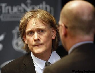 David Thomson attends news conference for the NHL's return to Winnipeg.