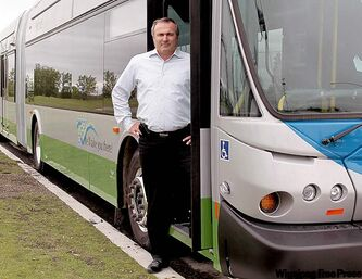 Paul Smith, executive vice-president of New Flyer Industries, with one of their buses destined for Miami.
