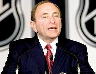 FILE - NHL commissioner Gary Bettman responds to a question during a news conference in 2009.