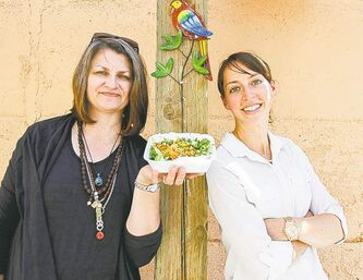 For Laura Allard (left) and Kristen Mitteness, their food is locally grown and chemical- and antibiotic-free.