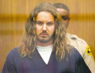 Timothy Lambesis, frontman for metal band As I Lay Dying, tried to hire an undercover officer to kill his estranged wife, his preliminary hearing was told.   FILE - In this May 9, 2013 file photo, Tim Lambesis, 32, front man for the Christian-inspired heavy metal group As I Lay Dying, appears in Vista Superior Court in Vista, Calif.  Lambesis is facing a court hearing Monday Sept. 16, 2013 to determine whether he will stand trial on charges he tried to hire someone to kill his estranged wife. (AP Photo/U-T San Diego, Bill Wechter, Pool, File)