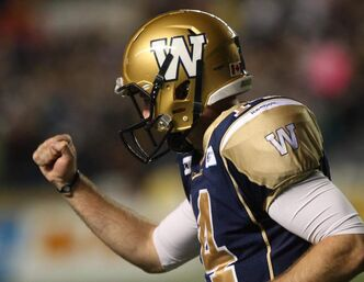 Winnipeg Blue Bombers quarterback Joey Elliott celebrates the game-winning fourth-quarter touchdown against the Hamilton Tiger-Cats Thursday.