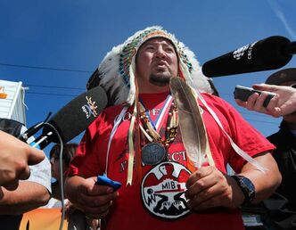 AMC Grand Chief Derek Nepinak has thrown away his status card at a meeting of chiefs unhappy with the leadership of the Assembly of First Nations.