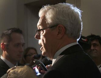 Premier Greg Selinger rejected Conservative Opposition calls today that one of his ministers be dropped from cabinet for a comment he made about the 'ignorance of do-good white people.'