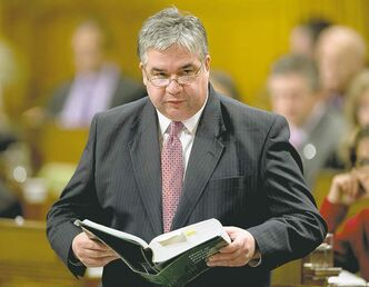 Government House Leader Peter Van Loan reads from a procedural book as he responds to a point of order following question period in the House of Commons Wednesday December 5, 2012 in Ottawa. THE CANADIAN PRESS/Adrian Wyld
