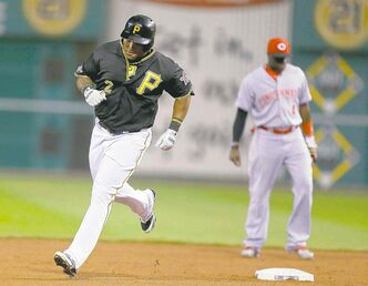 Pittsburgh's Marlon Byrd (left) rounds the bases after homering in the second inning Tuesday night.